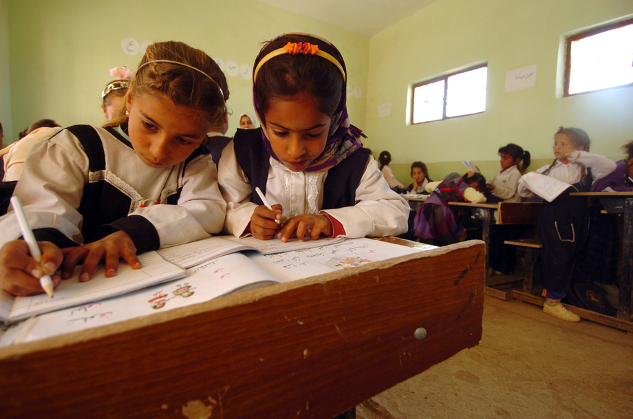 Large us navy 050322 n 5319a 013 iraqi schoolchildren study grammar as u.s. army soldiers assigned to the 155th brigade combat team  bct  from tupelo  miss.  deliver school supplies