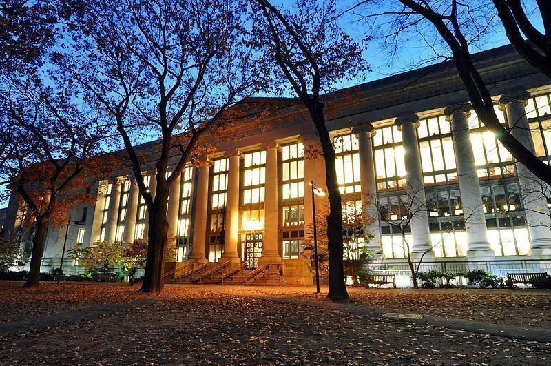 Large large harvard law school library in langdell hall at night